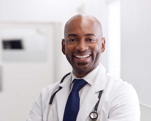 portrait-of-mature-male-doctor-wearing-white-coat--H49URGD-b